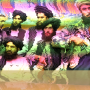 A distorted version of the photo that the Taliban distributed showing them taking over the President's Office in Afghanistan.