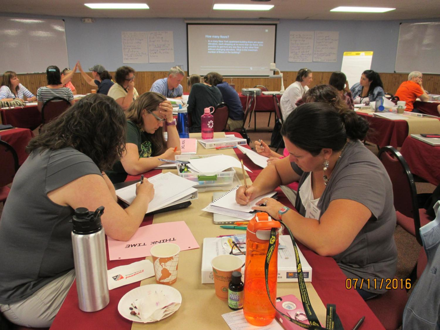 Teachers work together at a summer workshop