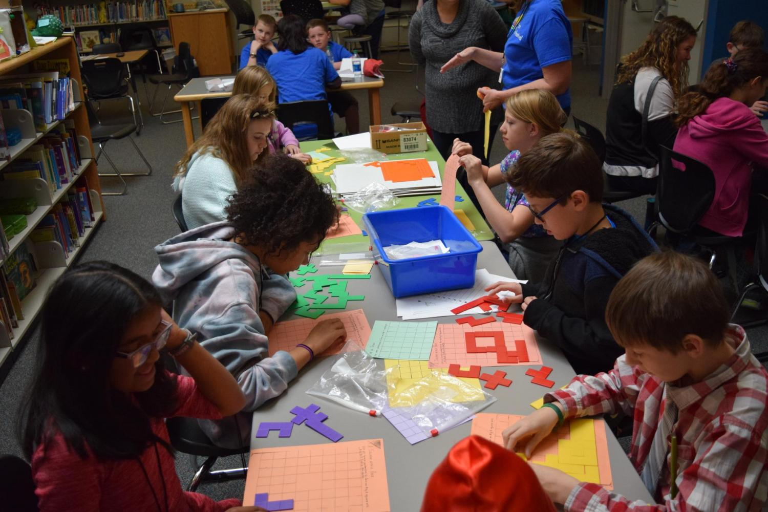 Students get involved in hands-on math activities.