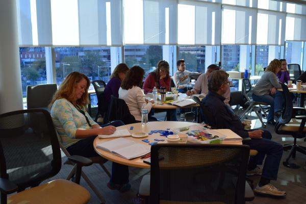 Teachers engage in math problems in Downtown Denver at the October RMMTC meeting.