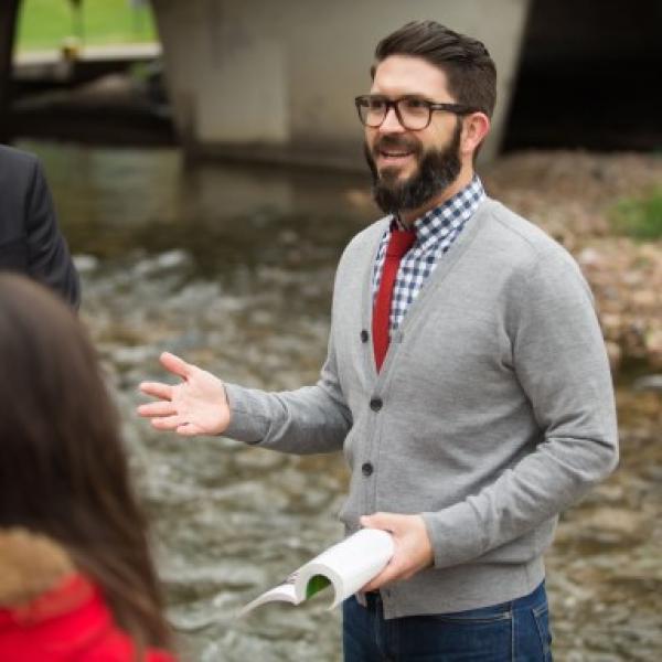 Teacher by a river