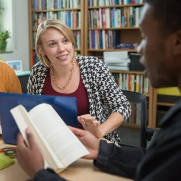 Students discussing a book