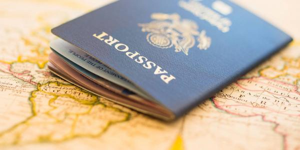 Photo of passport laying on top of map