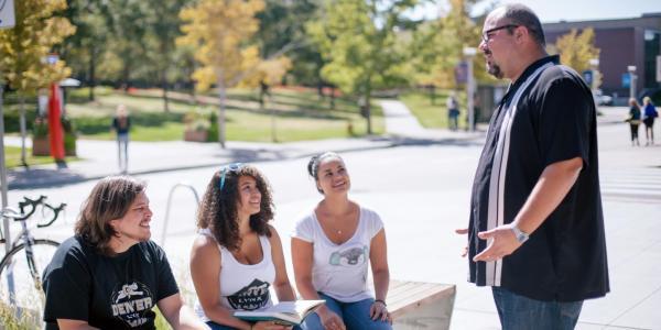 Carlos Reali talking with undergraduate students