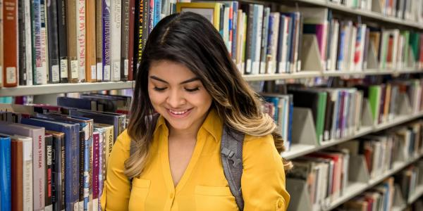 Photo of student reading book