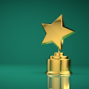 A gold star trophy against a green background.