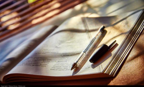 image of book and pen