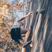 person climbing a wall