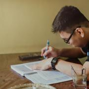 person writing at a desk